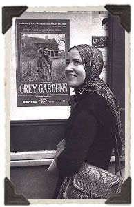 """The original artwork for the Grey Gardens poster included an angel design in the """"G"""" of """"Grey Gardens.""""  It was inspired by Lois Wright, but was later changed in favor of the photo of Little Edie standing outside the home."""