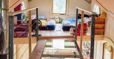 Upstairs you'll see something very unusual: two lofts connected by a glass bridge. The childrens' bedroom is on one end with toys and couch beds, a… | Pinteres…