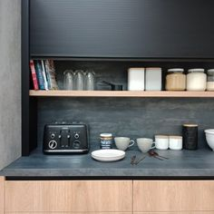 Roller Doors - what would you store, behind your door | Sage Doors Ltd Concrete Color, White Concrete, Concrete Wall, Roller Doors, White Building, Splashback, Sheet Sizes, Floating Shelves, Pantry
