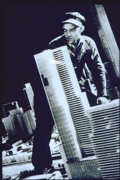 """""""Futurama,"""" New York World's Fair, 1939. A workman with a scale model of a large skyscraper gives the city a sense of scale."""