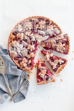 Rhubarb + raspberry tart with almond praline. @thecoveteur