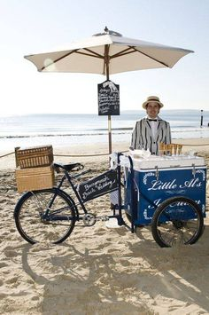 An Ice Cream Trike parked by the Beach.