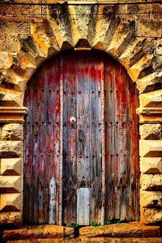 weathered red door Cyprus