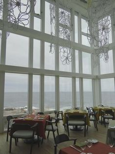 Chandeliers in the inn's dining room resemble nautical knots. Fogo Island Inn, Nautical Knots, Newfoundland And Labrador, Amazing Places, Chandeliers, The Good Place, Dining Room, Earth, Luxury