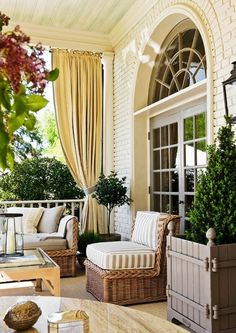 outdoor elegance. Love the idea of outdoor fabric curtains on the patio. Makes the area look like an indoor living space.