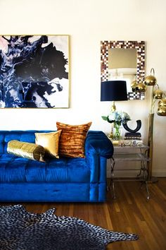 Transitioning into Fall at Home - velvet blue sofa and cheetah rug #songofstyle