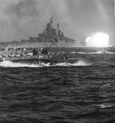 USS Tennesee (BB-43) giving covering fire while a LVT-4 B111 heads for the beach at Okinawa April 1, 1944.