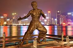 Bruce Lee statue on the Avenue of Stars near the waterfront at Tsim Sha Tsui. Lee was born Lee Jun-fan in San Francisco but raised in Kowloon until his teens.