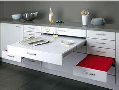 Dining Table and Seating Pull Out Of Kitchen by Alno  This innovative kitchen solution is designed by German kitchen manufacturer ALNO.What a clever idea, a pullout dining area when you need it, built rightinto the kitchen cabinetry and pulling out like drawers. I don't know how they get such a big table into the counter, perhaps there is a fold in it.