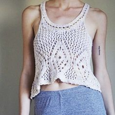 Free People crocheted cropped tank Adorable crop top from Free People. In great condition. The only flaw is that one side of the tag came undone. Size S. Shuts with very pale yellow and purple threads mixed in. Free People Tops Crop Tops