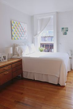 Jacqueline has made her bright and airy 400 square foot New York City studio apartment serve as a living and work space.