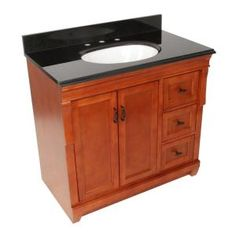 Foremost Naples 37 in. W x 22 in. D Vanity with Right Drawers in Warm Cinnamon with Granite Top in Black.    This looks good and at $747 from Home Depot it is very affordable and could help make the project feasible.  Still need the mirror and faucet plus plumber.