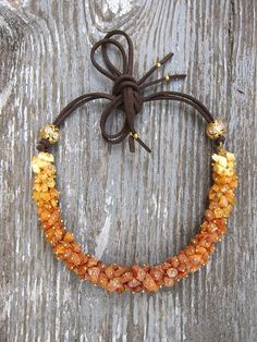 Raw amber necklace Baltic amber jewelry Amber and leather Chunky amber necklace Baltic amber necklace unique Birthday gift idea for women  ✿ This beautiful accessory will make a big statement. Perfect to wear to office or as casual look. ✿ Necklace is 1 strand of approx. 8-15mm golden-yellow natural baltic amber beads (raw, untreated).  ✿ Necklace beaded part 10, 11, 12 (appr. 25; 27,5 30 cm). Each bead sits on its own individual head pin. Pls, select your length preferences during check…