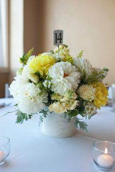 Grey and yellow wedding centerpiece + anthropologie table number