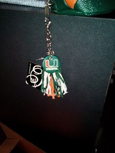 Cyber Monday Miami Hurricanes Pom Pom Charm: Miami FanWear apparel and merchandise..ON SALE NOW! $1.95..We are located at 2635 S University Dr in Davie, FL or visit us online at www.CanesWear.com! See U there! #miamihurricanes #miamifanwear #caneswear #canesgear #pompom #keychain #orangeandgreen #miamisports #theU #ladycane #ladycanes #canesfans #itsallabouttheU