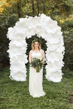 This paper flower ceremony backdrop and arch is insane, y'all! | Lori Blythe Photography