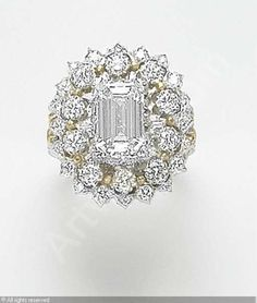 Buccellati Diamond Ring . Centering upon an emerald-cut diamond, weighing approximately 2.14 carats, within a two-tiered circular-cut diamond foliate surround.
