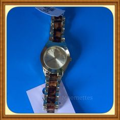 NEW LOFT Tortoise Gold Tone Watch NWT Stunning LOFT Faux Tortoise Gold Tone Watch New with Tags Quartz movement with minute & hour hands Battery operated  Trades LOFT Jewelry