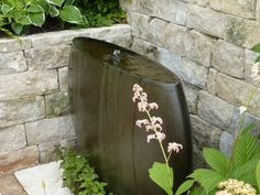 Love this water feature - A sculptural and safe fountain in a garden for the blind.  http://blog.theenduringgardener.com/best-of-the-urban-gardens/