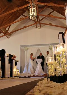 Black and white Ceremony decor, aisle decor, candles and petals | Designed by Perfect Princess Events
