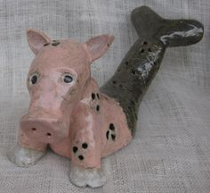 MerPig:) Completely hollow, made with gray glad.