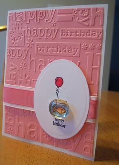 +use crystal effects for mailable option + so clever!  I have the sizzix embossing folder and this stampin' up stamp, and glass beads.  Ok for hand carried cards - probably can't mail unless enclosed in package.  Mass produce in a gender neutral color :)