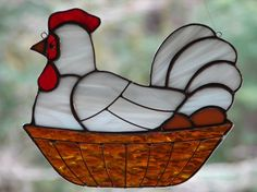 This laying hen is all comfy sitting on her brown eggs! This delightful chicken in a basket measures about 5 1/2 x 6 1/2