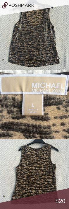 Michael Kors sequin top Very cute Michael Kors tank top. Front is covered in sequins. The back is regular material, 100% rayon. This is great for work, or play. Size large. Michael Kors Tops Tank Tops