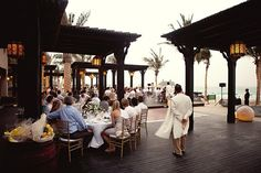 "The Madinat Jumeirah or the ""City of Jumeirah"" is a chain of 3 luxurious, extraordinarily beautiful and modern hotels and resorts. Perfect for a wedding insode and out!"