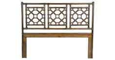 Rattan poles given a rich mahogany finish and arranged in a formal geometric motif provide this headboard with a decided British colonial feel. The joints are wrapped in leather for durability and...