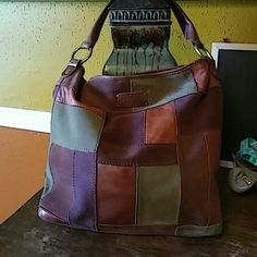 """Lucky Brand Hobo Pretty patchwork leather and suede hobo with magnetic closure. A little dirty and a spot on the bottom as pictured. Strap drop is 11"""". Lucky Brand Bags Hobos"""