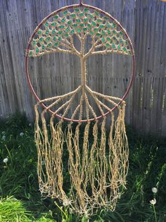 ~ Large Macrame Wall Hanging Large Dream Catcher Tree of Life Wall Art Hippie Tapestry Tree of Life Dreamcatcher Natural Hemp 19 Inch Hoop ~  LAST ONE AVAILABLE. Made with natural hemp and beautiful glass beads! Choose from 12 colors to make your Tree of Life wall hanging a unique piece in your bohemian home.  DIMENSIONS Hoop diameter- 19 inches (48.26 cm) Length from top of hoop- 40 inches(101.6 cm).  HOW TO ORDER There are 12 colors to choose from in the last picture. IF you choose more…