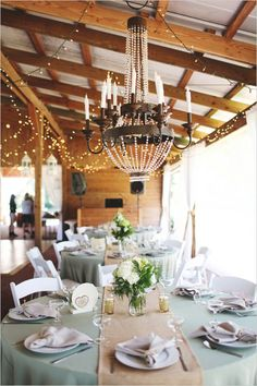 Candlelit chandeliers at wedding reception. Captured By: Vine and Light Photography ---. http://www.weddingchicks.com/2014/05/14/soft-southern-vintage-wedding/