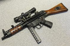 Heckler & Koch MP5 with wooden stock set. - http://www.rgrips.com/en/article/8-anschutz-54