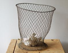 Trash can be pretty when it's tossed into this antique French wire basket. #countryliving