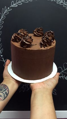 Chocolate Wasted- chocolate cake layered and frosted with whipped chocolate ganache. Topped with ganache drizzle and dark chocolate covered rice crisps.