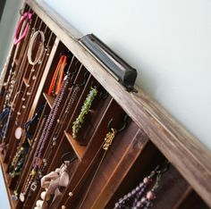Jewelry organizer. Great use of an old drawer!
