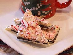 Layered Peppermint Crunch Bark:  whipped cream, peppermint extract, peppermint candy canes, bittersweet chocolate, white chocolate, white chocolate, peppermint candy canes, bittersweet chocolate, whipped cream, peppermint extract
