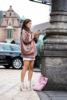Pair a casual t-shirt dress with an oversized bomber jacket for a cool street style look. // #StreetStyle www.glamourmarmalade.com
