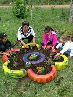 My aunt had done something like this. Using one tire for one planter look nice too.