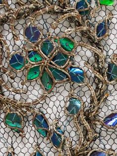 Beetle fabric, c. 1880. The blues and greens are real beetle wings, used to achieve an appearance similar to snake scales.