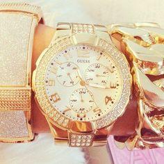 Gold Guess watch & bracelets