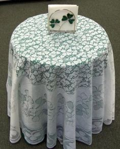 Designed with a lacy and open work shamrock pattern this tablecloth will add a fresh Irish look to your table. 72 inches round.