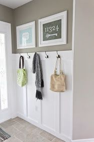 painted 2X4 with hooks! perfect for the front door!!
