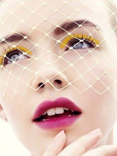 Girl with white Fishnet veil over face  & yellow eye shadow