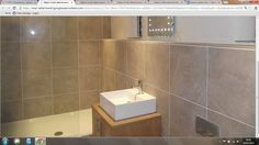 Shower, Basin and shelf to hide everything..Also like the big tiles!