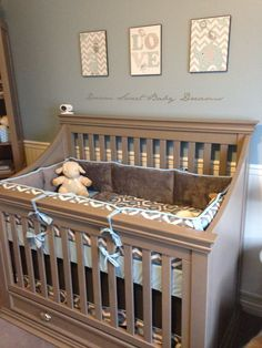 Our nursery for baby boy. Slate blue, grey and white. Chair rail and wainscotting for the walls. Linens by Carousel Designs (www.babybedding.com)