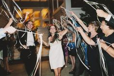 streamer and bells exit - brett & jessica - wedding photographers - brettjessica.com
