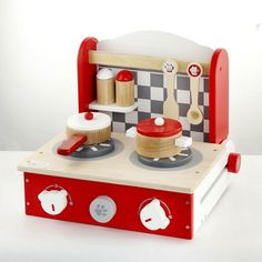 """Wooden Cooker Take your cooking play wherever you go with the Foldable Tabletop Cooker. Includes 1 spoon, 1 spatula, 1 pot with lid, 1 sauce pan with lid and salt & pepper pots. At the end of play it folds away. Hours of kitchen play fun with this great wooden playset. Product Features: Easy folds away for easy storage. Cooker dials include """"click clack"""" sounds Beautifully crafted and painted Size: 310 x 300 x 95 mm Recommended for ages 3 years+. Safety: All Viga toys are made with non-toxic…"""