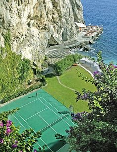Backhand with a View: With towering cliffs to one side and the sparkling Mediterranean to the other, it's all but impossible to keep an eye on the ball at the courts of Italy's Il San Pietro di Positano resort.